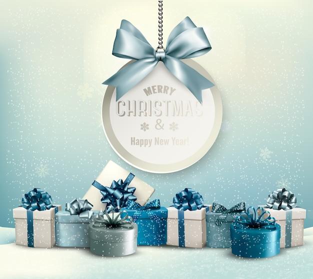 С рождеством христовым открытка с лентой и подарочными коробками. Premium векторы