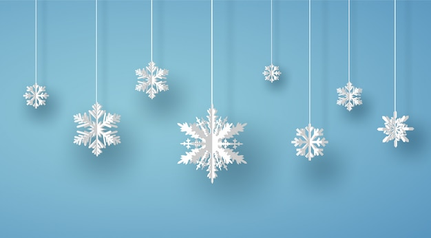 Merry christmas card with white origami snowflake or ice crystal on blue background Premium Vector