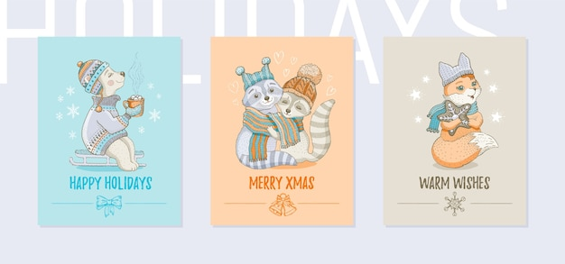 メリークリスマスグリーティングカードセット。ホッキョクグマ、アライグマ、キツネとかわいい冬の動物のポスター Premiumベクター