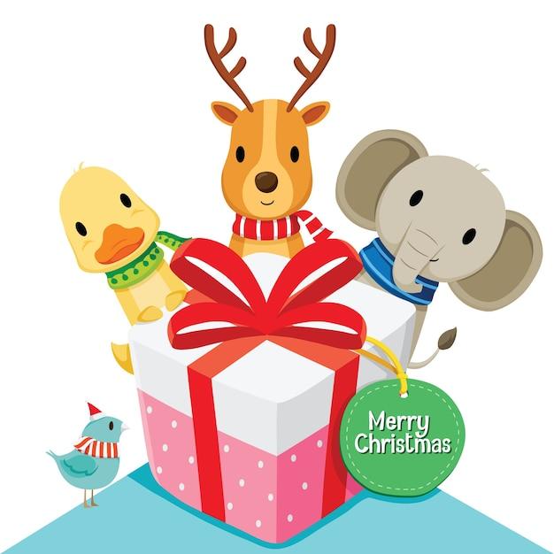 ギフトボックスとメリークリスマスの挨拶 Premiumベクター
