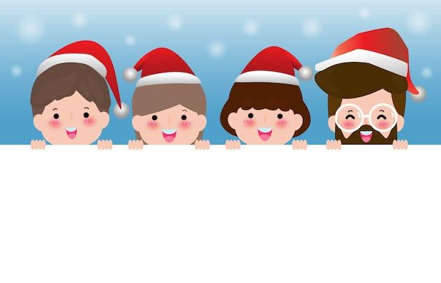 Веселого рождества, счастливого нового года, группа друзей в рождественских шляпах с большой вывеской Premium векторы