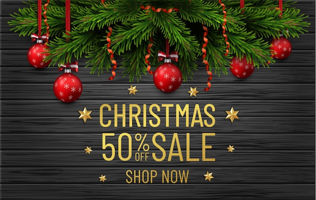 Merry christmas and happy new year sale banner. christmas tree border with golden decorations on black wood Premium Vector
