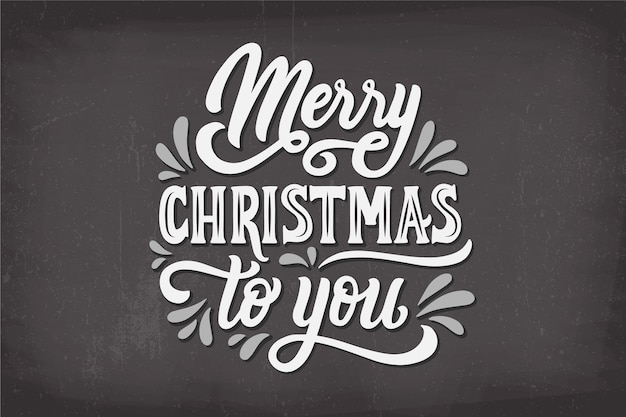 Merry christmas lettering on christmas photo Free Vector