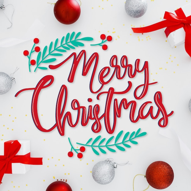 Merry christmas lettering on christmas picture Free Vector