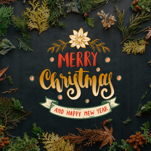 Merry christmas lettering design Free Vector