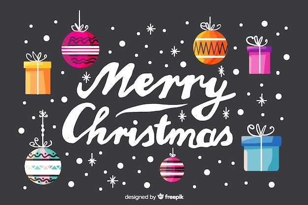 Merry christmas lettering with christmas decoration Free Vector