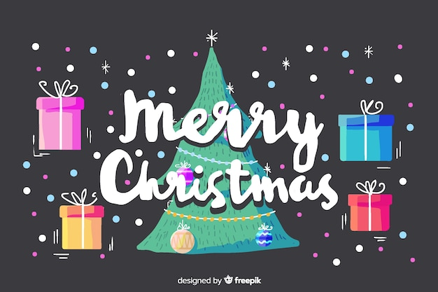 Merry christmas lettering with gifts and christmas tree Free Vector