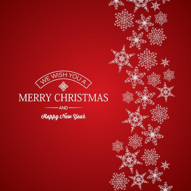 Buon natale e anno nuovo saluto carta iscrizione e fiocchi di neve di diverse forme su colore rosso Vettore gratuito