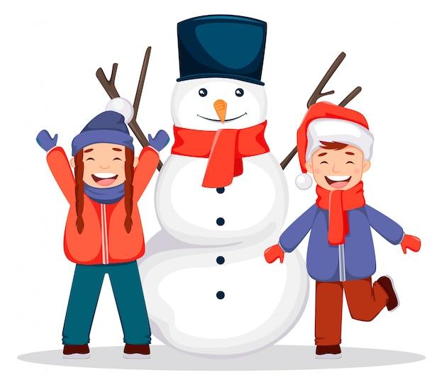 Merry christmas. snowman and kids Premium Vector