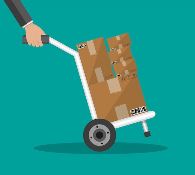 Metallic hand truck with boxes Premium Vector