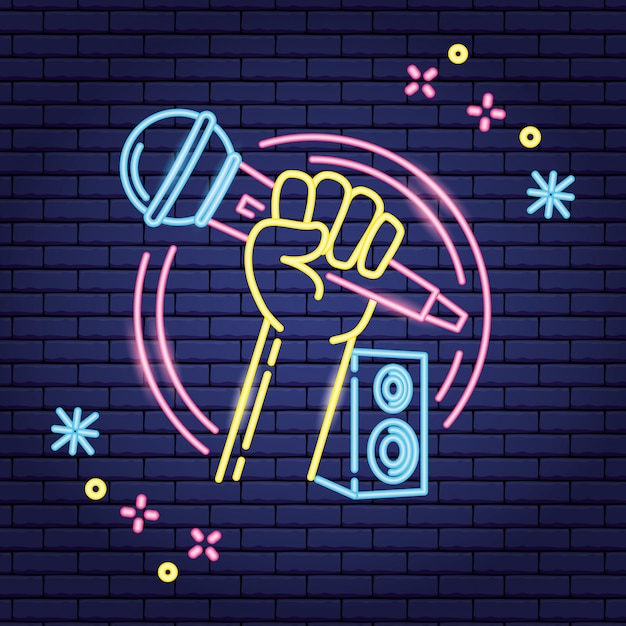 Microphone and speaker in neon style over purple Free Vector