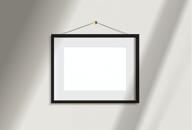 Минимальная пустая картина черноты рамки ландшафта вися на белой стене с светом и тенью окна. изолировать иллюстрации. Premium векторы