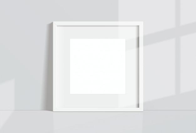 Минимальная пустая квадратная белая рамка изображение висит на белой стене с окном света и тени. изолировать иллюстрации. Premium векторы