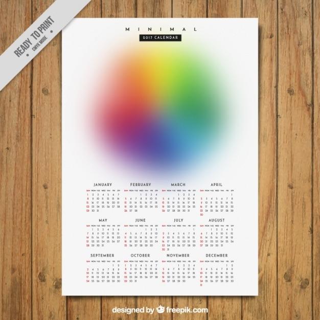 Minimalist new year calendar of defocused colors Free Vector