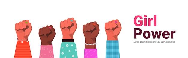 Mix race raised up women's fists female empowerment movement girl power union of feminists concept copy space horizontal vector illustration Premium Vector