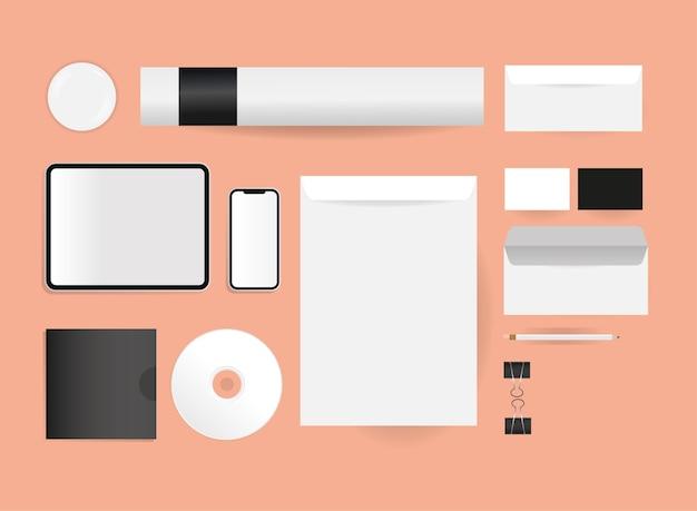 コーポレートアイデンティティテンプレートとブランディングテーマのモックアップ封筒cdタブレットとスマートフォンのデザイン Premiumベクター
