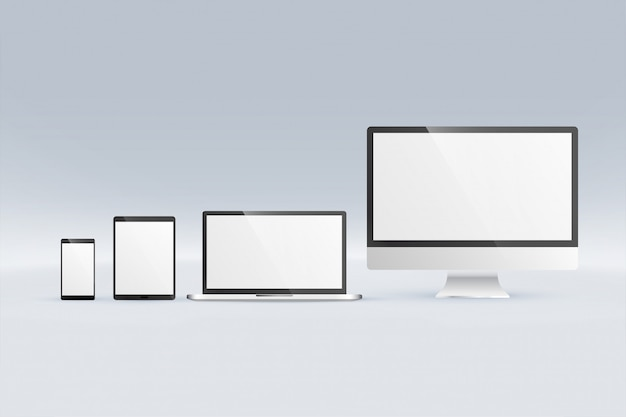 Mockup of monitor computer laptop tablet and smartphone Free Vector