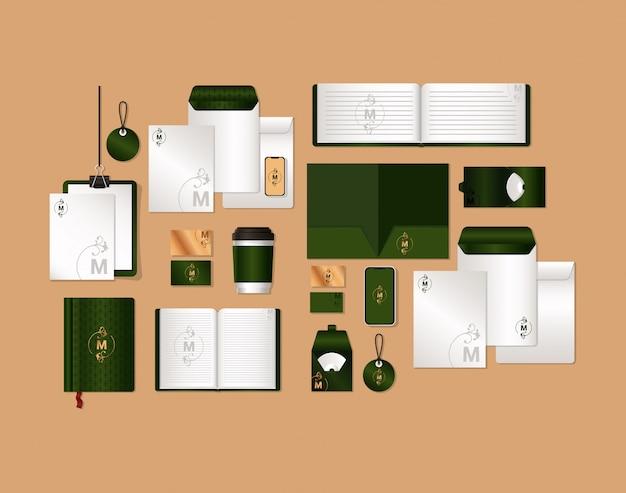 コーポレートアイデンティティと文房具のデザインテーマのグリーンとmのブランディングが設定されたモックアップ Premiumベクター