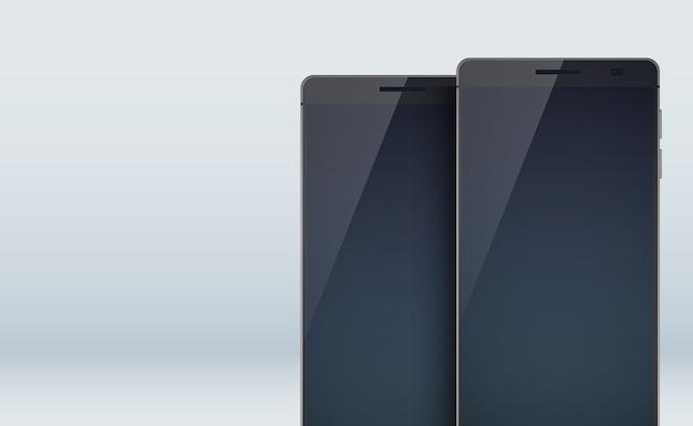 大きな空白のディスプレイに影が付いた2つのスタイリッシュな黒いスマートフォンと灰色のタッチスクリーンを備えたモダンなデザインコンセプトセットコレクション 無料ベクター