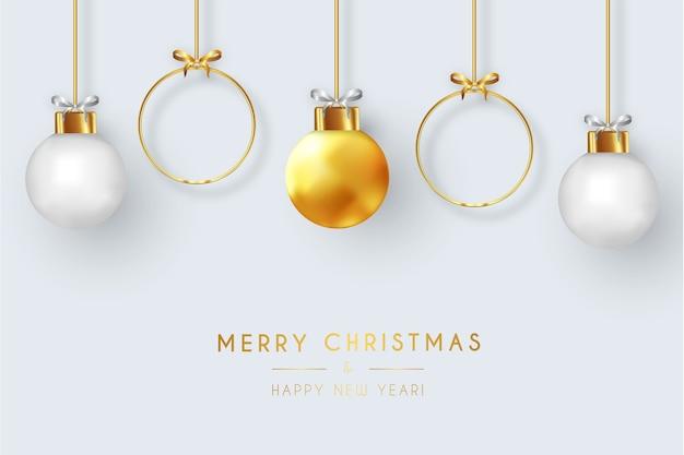 リアルなクリスマスボールとモダンなメリークリスマスカード 無料ベクター