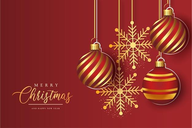Современная рамка с рождеством и реалистичными золотыми елочными шарами Бесплатные векторы