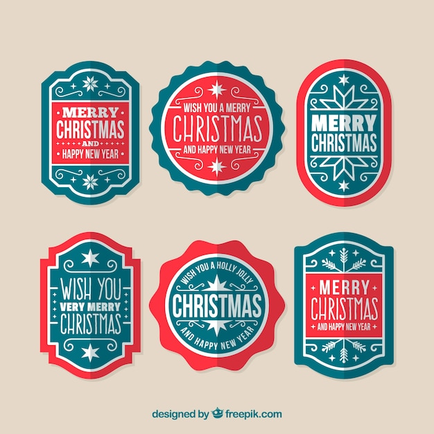 Modern pack of christmas badges Free Vector