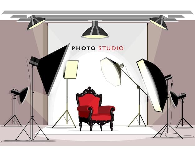 Modern photo studio interior with lighting equipment and armchair. Premium Vector