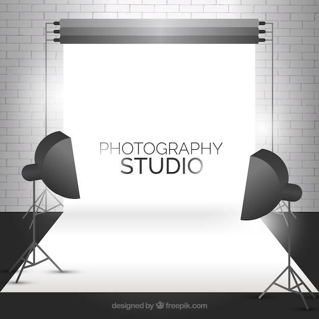 Modern photo studio with a bricks wall