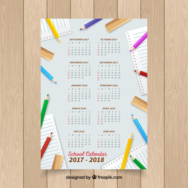 Modern school calendar with colorful pencils