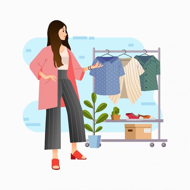 Современные стильные молодые женщины выбирают блузку в гардеробе Premium векторы