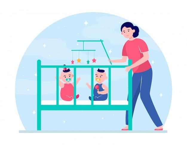 ママがベビーベッドで双子の赤ちゃんを落ち着かせる 無料ベクター
