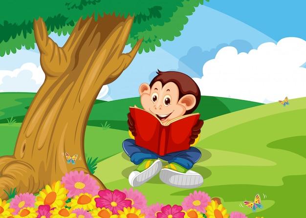 Monkey reading book in garden Free Vector