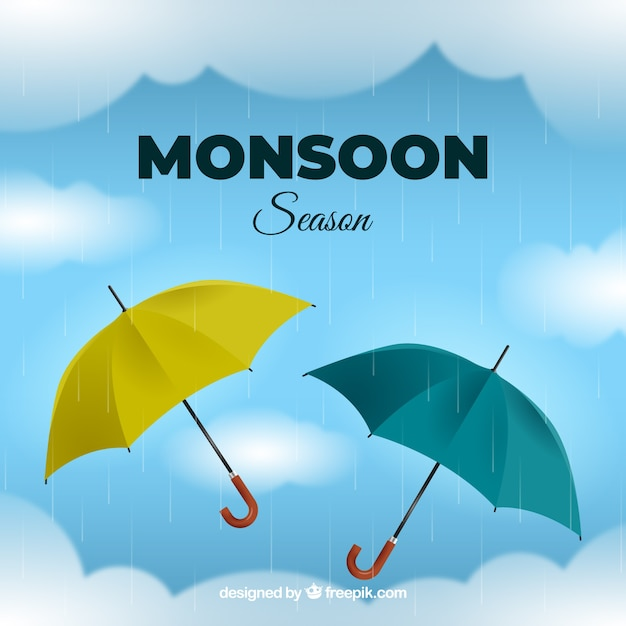 Monsoon season background with realistic\ umbrellas