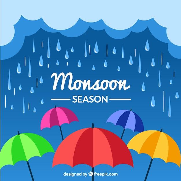 Monsoon season background with umbrellas Free Vector