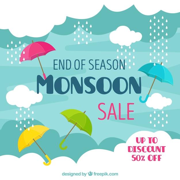 Monsoon season sale background with umbrellas Free Vector