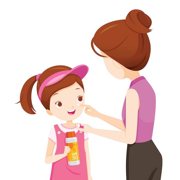 娘の顔に日焼け止めを着ている母親 Premiumベクター