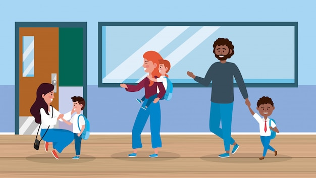 Mothers and father with their boys and girl in the classroom Free Vector