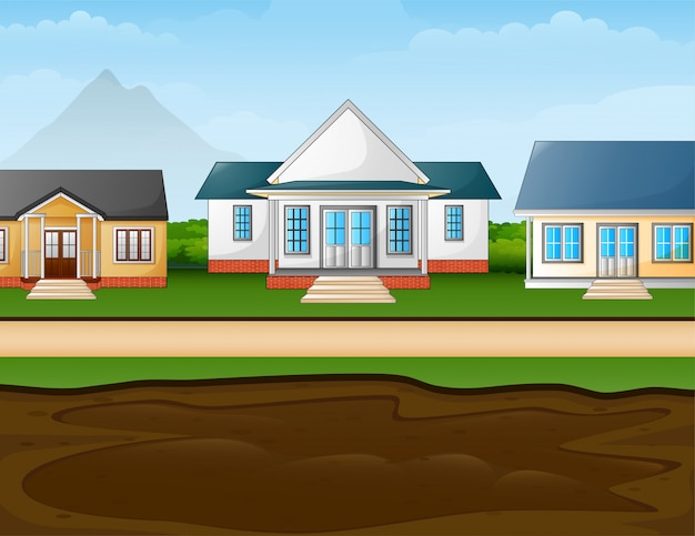 A muddy puddle in front the suburban houses Premium Vector