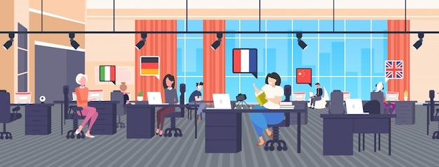 Multi language translators using dictionary vocabulary chat bubble communication social media network blogging concept modern office interior horizontal full length Premium Vector
