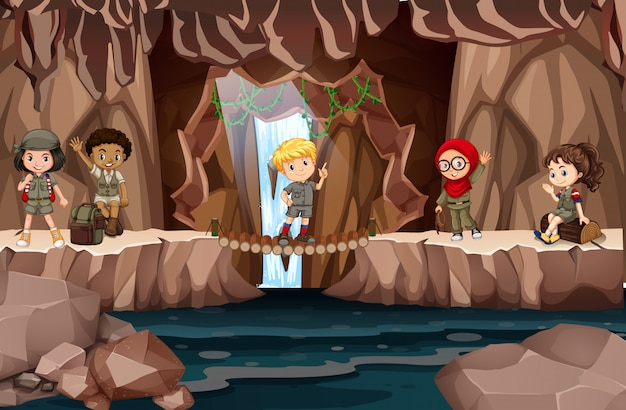 Multicultural kids in the cave Premium Vector