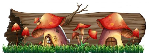 Mushroom houses by the log Free Vector