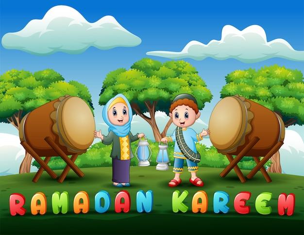 Muslim boy and girl holding lantern for ramadan Premium Vector