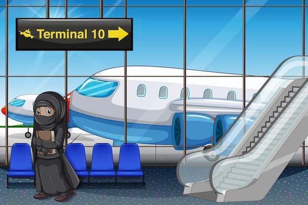 空港ターミナルでイスラム教徒の少女 無料ベクター