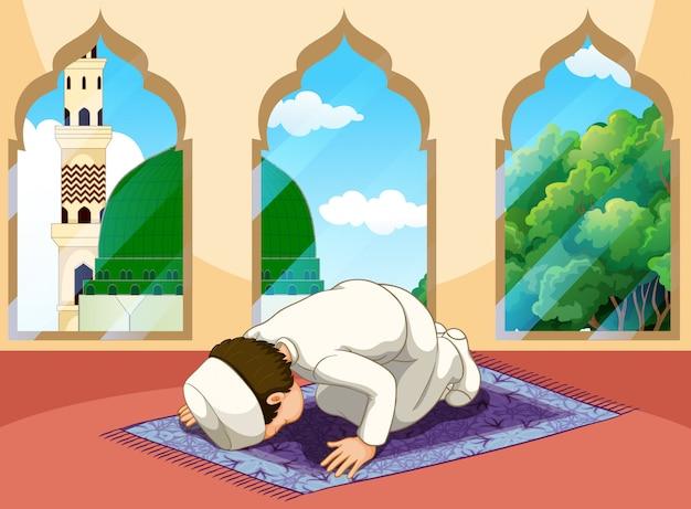 A muslim man pray at mosque Premium Vector