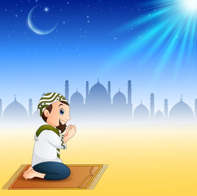 Muslim men sitting on the prayer rug while praying Premium Vector