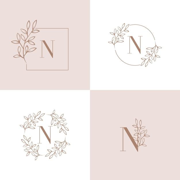 蘭の葉の要素を持つ文字nロゴデザイン Premiumベクター