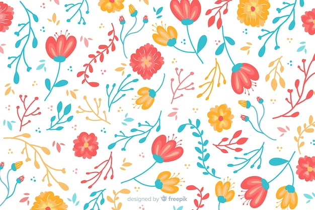 Natural background with hand drawn flowers Free Vector