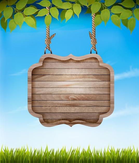 葉と木製の看板と自然な背景。 Premiumベクター