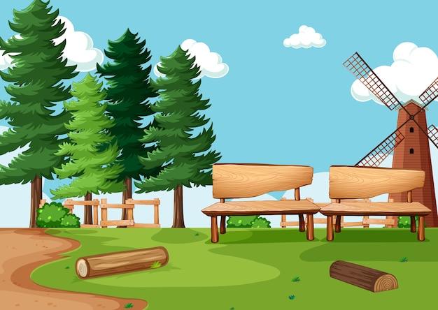 風車のある自然公園や農場のシーン Premiumベクター