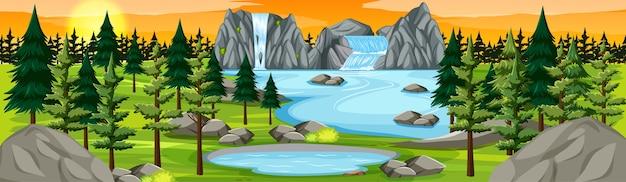 日没のシーンで滝の風景のパノラマと自然公園 無料ベクター